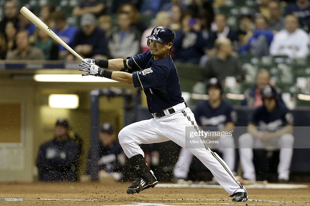 <a gi-track='captionPersonalityLinkClicked' href=/galleries/search?phrase=Norichika+Aoki&family=editorial&specificpeople=850957 ng-click='$event.stopPropagation()'>Norichika Aoki</a> #7 of the Milwaukee Brewers singles in the bottom of the 1st inning against the San Diego Padres at Miller Park on October 1, 2012 in Milwaukee, Wisconsin.