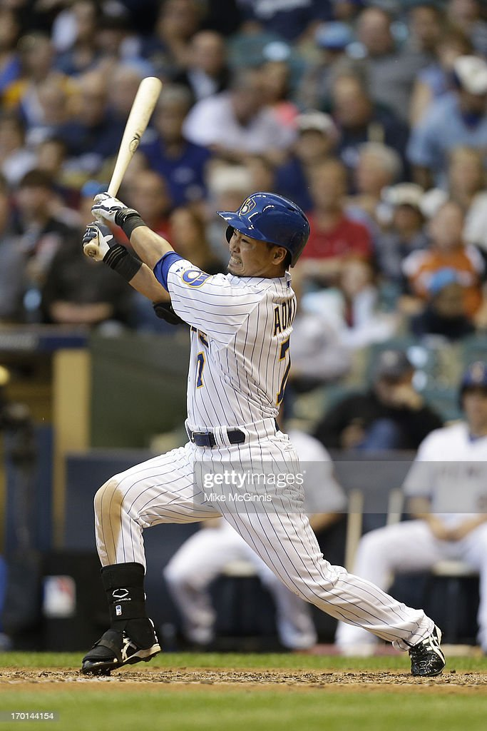<a gi-track='captionPersonalityLinkClicked' href=/galleries/search?phrase=Norichika+Aoki&family=editorial&specificpeople=850957 ng-click='$event.stopPropagation()'>Norichika Aoki</a> #7 of the Milwaukee Brewers singles in the bottom of the third inning against the Philadelphia Phillies at Miller Park on June 07, 2013 in Milwaukee, Wisconsin.