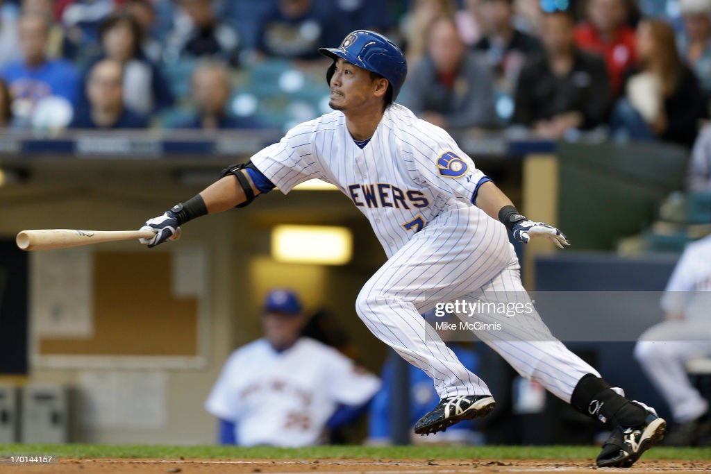 <a gi-track='captionPersonalityLinkClicked' href=/galleries/search?phrase=Norichika+Aoki&family=editorial&specificpeople=850957 ng-click='$event.stopPropagation()'>Norichika Aoki</a> #7 of the Milwaukee Brewers singles in the bottom of the first inning against the Philadelphia Phillies at Miller Park on June 07, 2013 in Milwaukee, Wisconsin.