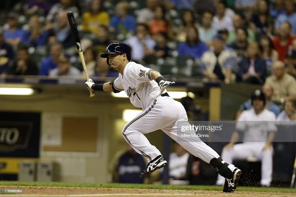 <a gi-track='captionPersonalityLinkClicked' href=/galleries/search?phrase=Norichika+Aoki&family=editorial&specificpeople=850957 ng-click='$event.stopPropagation()'>Norichika Aoki</a> #7 of the Milwaukee Brewers singles in the bottom of the ninth inning against the Cincinnati Reds during the game at Miller Park on August 15, 2013 in Milwaukee, Wisconsin.