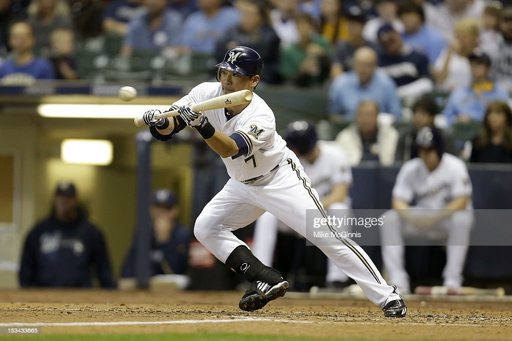 Norichika Aoki #7 of the Milwaukee Brewers squares up to bunt against the San Diego Padres at Miller Park on October 2, 2012 in Milwaukee, Wisconsin.
