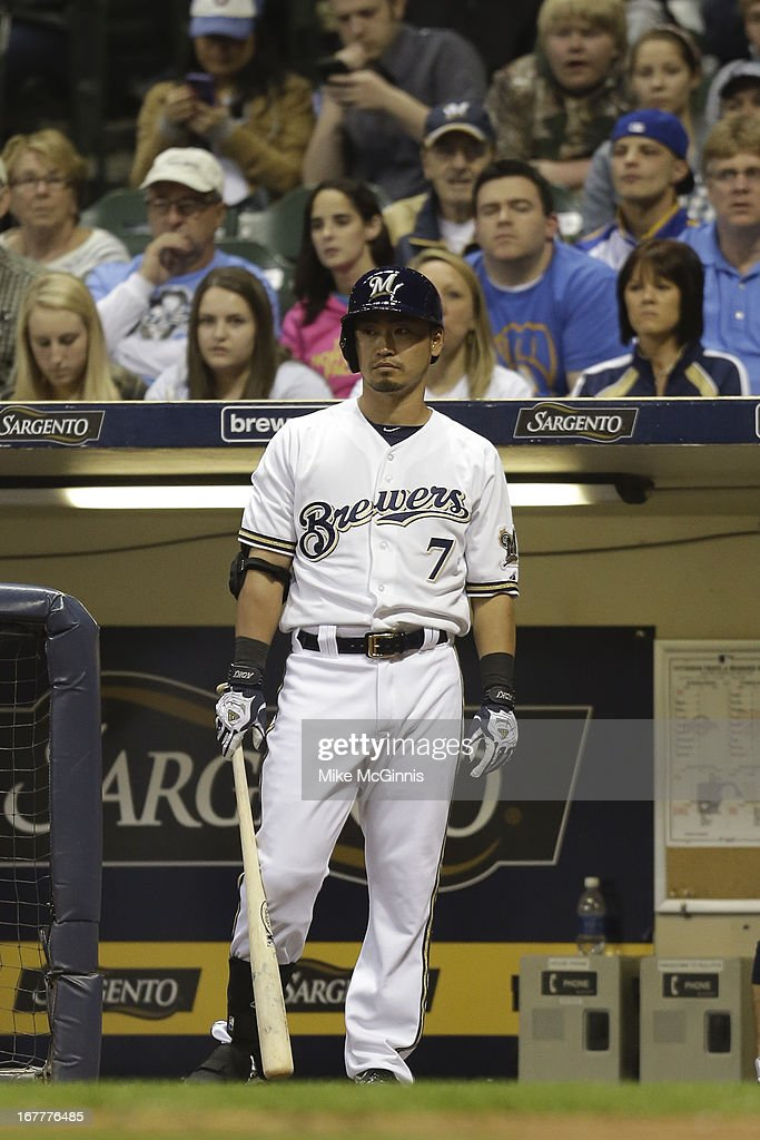 Norichika Aoki #7 of the Milwaukee Brewers stands on the edge of the dugout during the bottom of the fourth inning against the Pittsburgh Pirates at Miller Park on April 29, 2013 in Milwaukee, Wisconsin.