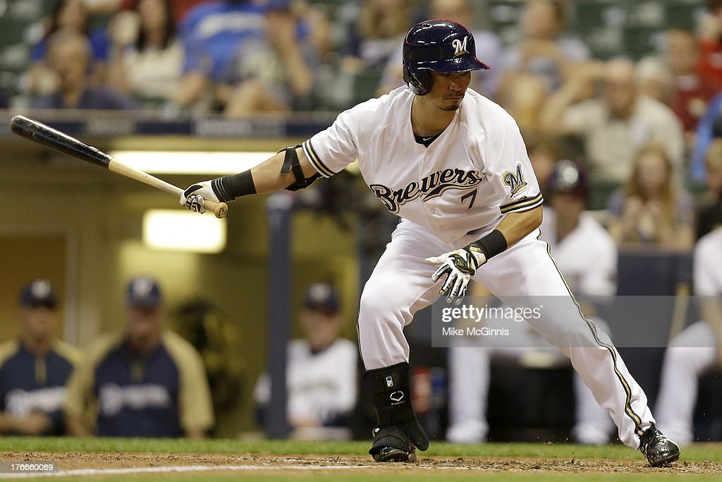 <a gi-track='captionPersonalityLinkClicked' href=/galleries/search?phrase=Norichika+Aoki&family=editorial&specificpeople=850957 ng-click='$event.stopPropagation()'>Norichika Aoki</a> #7 of the Milwaukee Brewers swings at strike three in the bottom of the fourth inning against the Cincinnati Reds at Miller Park on August 16, 2013 in Milwaukee, Wisconsin.