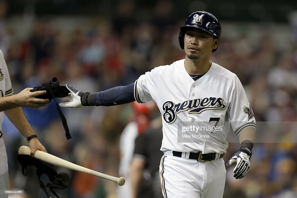 <a gi-track='captionPersonalityLinkClicked' href=/galleries/search?phrase=Norichika+Aoki&family=editorial&specificpeople=850957 ng-click='$event.stopPropagation()'>Norichika Aoki</a> #7 of the Milwaukee Brewers walks to first base after getting hit for the second time in today's game against the St. Louis Cardinals at Miller Park on May 04, 2013 in Milwaukee, Wisconsin.