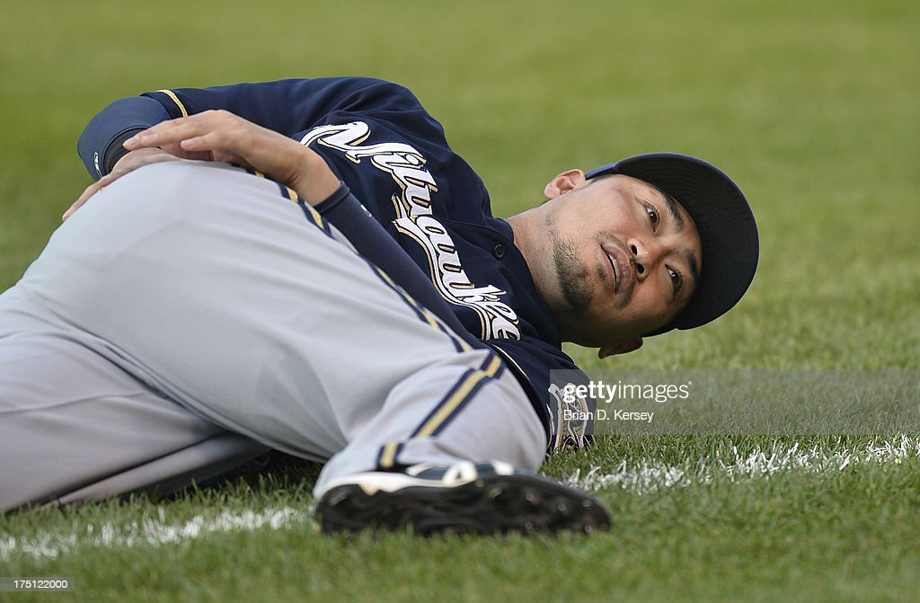 <a gi-track='captionPersonalityLinkClicked' href=/galleries/search?phrase=Norichika+Aoki&family=editorial&specificpeople=850957 ng-click='$event.stopPropagation()'>Norichika Aoki</a> #7 of the Milwaukee Brewers warms up before the game against the Chicago Cubs at Wrigley Field on July 31, 2013 in Chicago, Illinois. The Cubs defeated the Brewers 6-1.