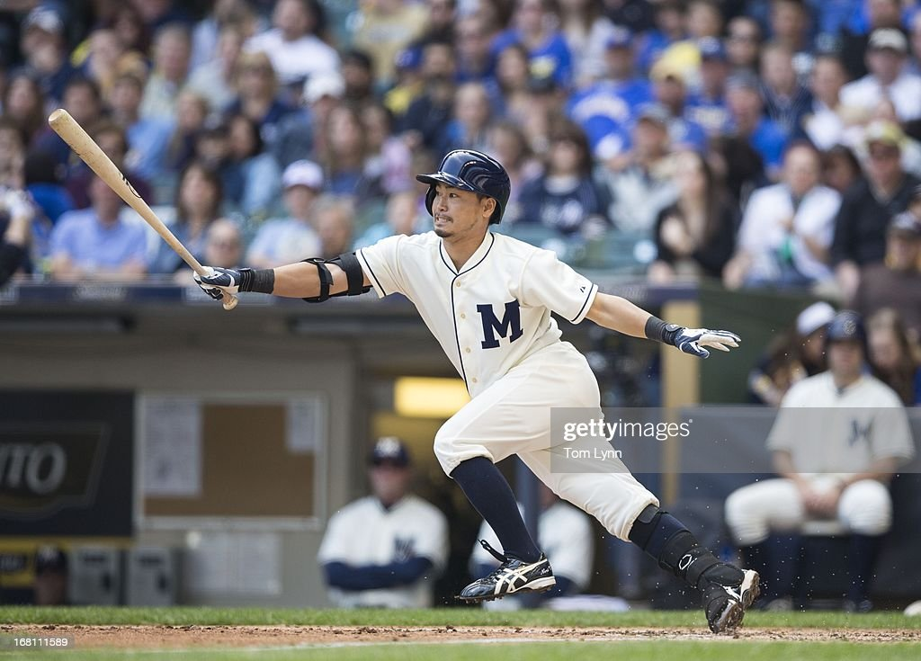 <a gi-track='captionPersonalityLinkClicked' href=/galleries/search?phrase=Norichika+Aoki&family=editorial&specificpeople=850957 ng-click='$event.stopPropagation()'>Norichika Aoki</a> #7 of the Milwaukee Brewers watches the ball against the St Louis Cardinals in the third inning at Miller Park on May 5, 2013 in Milwaukee, Wisconsin.