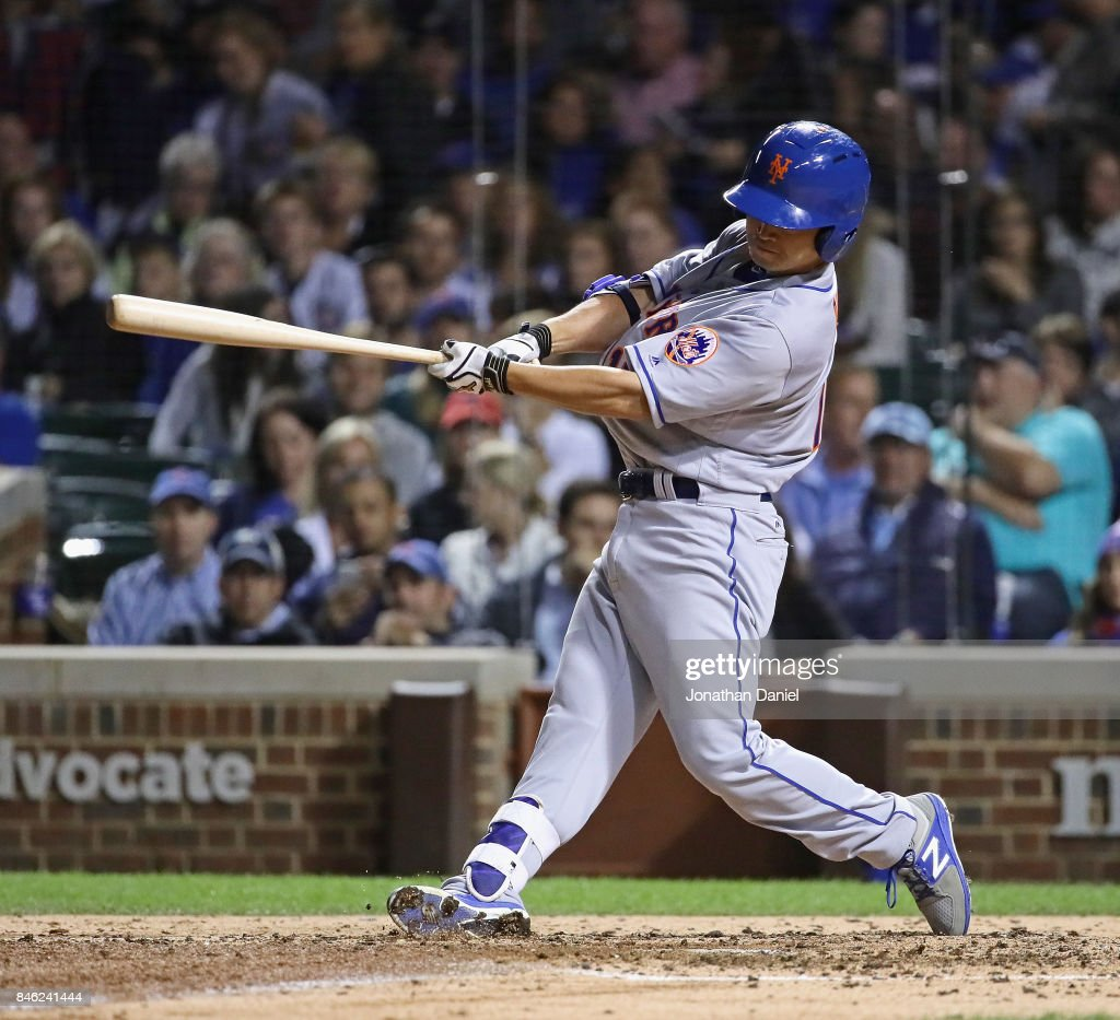 Norichika Aoki #11 of the New York Mets bats in the 5th inning against the Chicago Cubs at Wrigley Field on September 12, 2017 in Chicago, Illinois.