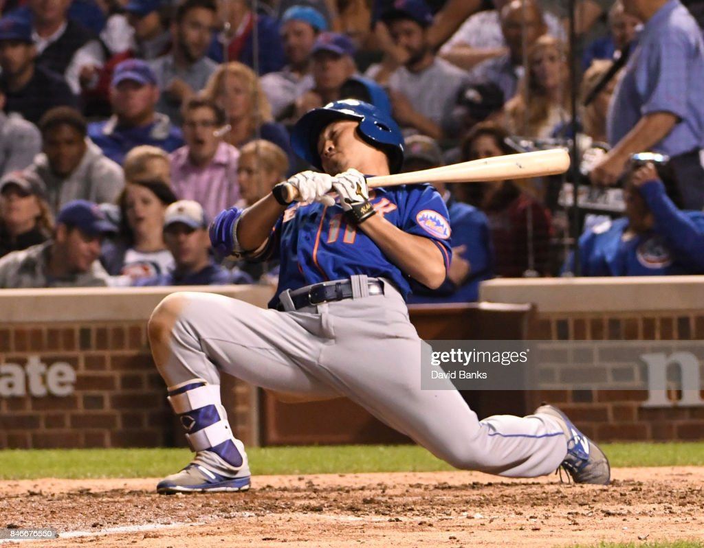Norichika Aoki #11 of the New York Mets gets out of the way of an inside pitch during the seventh inning of a game against the Chicago Cubs on September 13, 2017 at Wrigley Field in Chicago, Illinois.
