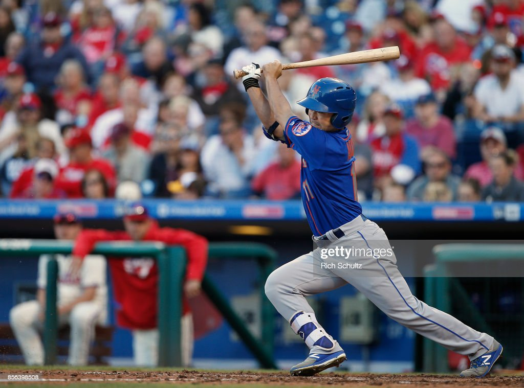 Norichika Aoki #11 of the New York Mets groundnut to shortstop against the Philadelphia Phillies during the seventh inning of a game at Citizens Bank Park on October 1, 2017 in Philadelphia, Pennsylvania.