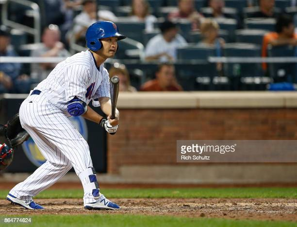 Norichika Aoki of the New York Mets grounds out in the eighth inning of the first game of a double header against the Atlanta Braves at Citi Field on...