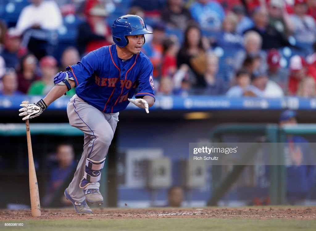 Norichika Aoki #11 of the New York Mets hits a single against the Philadelphia Phillies during the fifth inning of a game at Citizens Bank Park on October 1, 2017 in Philadelphia, Pennsylvania.