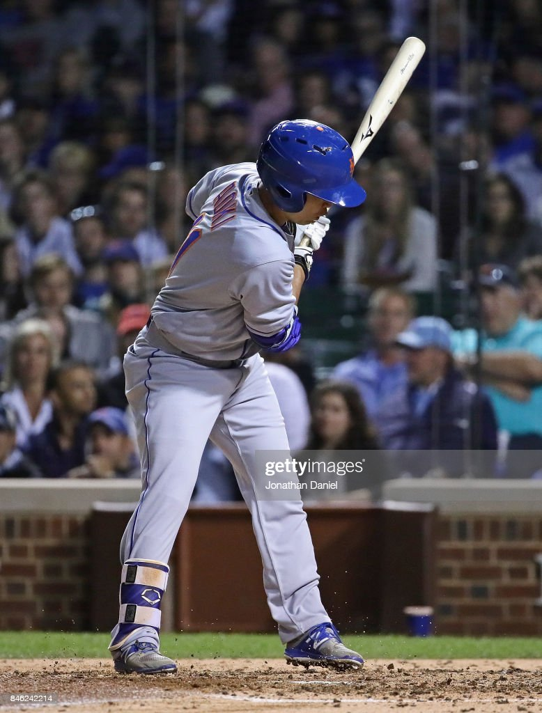 Norichika Aoki #11 of the New York Mets reacts after being hit by a pitch in the 5th inning against the Chicago Cubs at Wrigley Field on September 12, 2017 in Chicago, Illinois.