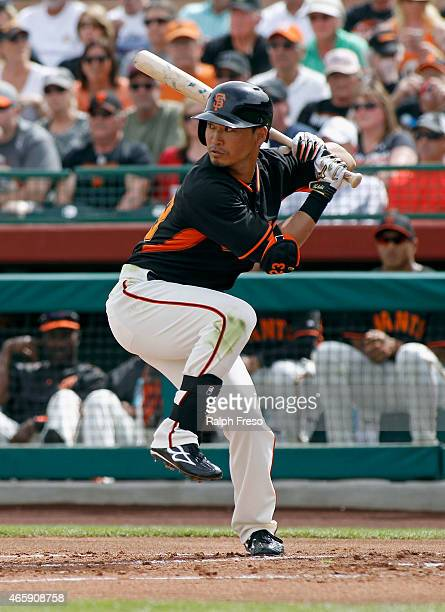 Norichika Aoki of the San Francisco Giants bats against the Milwaukee Brewers during the first inning of a Cactus League game at Scottsdale Stadium...