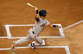 Norichika Aoki of the San Francisco Giants hits a ground ball out during the first inning of the MLB game against the Arizona Diamondbacks at Chase...