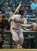 Norichika Aoki of the San Francisco Giants hits a single against the Arizona Diamondbacks during the first inning of the MLB game at Chase Field on...