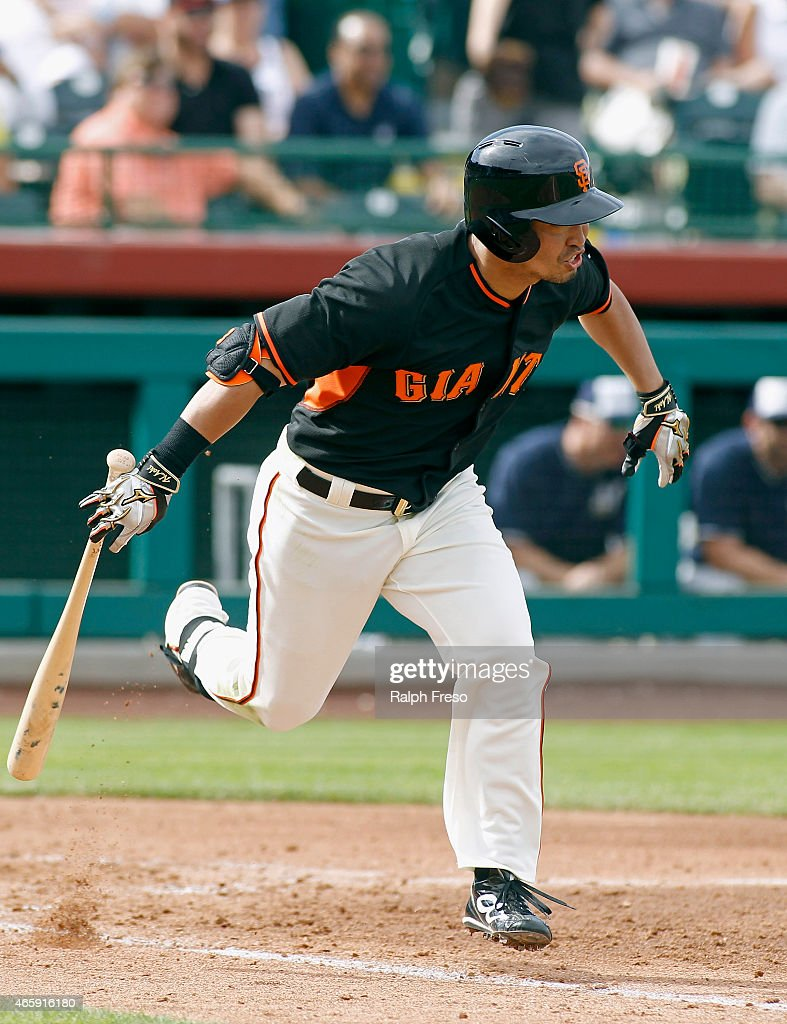 Norichika Aoki of the San Francisco Giants runs to first on a ground ball against the Milwaukee Brewers during the fifth inning of a Cactus League...