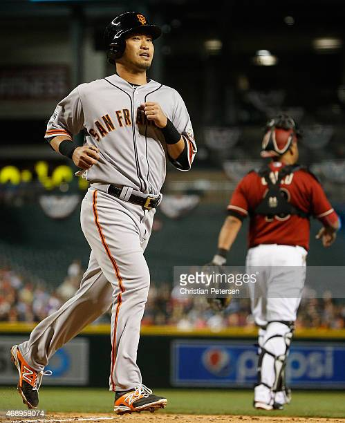 Norichika Aoki of the San Francisco Giants scores a run against the Arizona Diamondbacks during the second inning of the MLB game at Chase Field on...