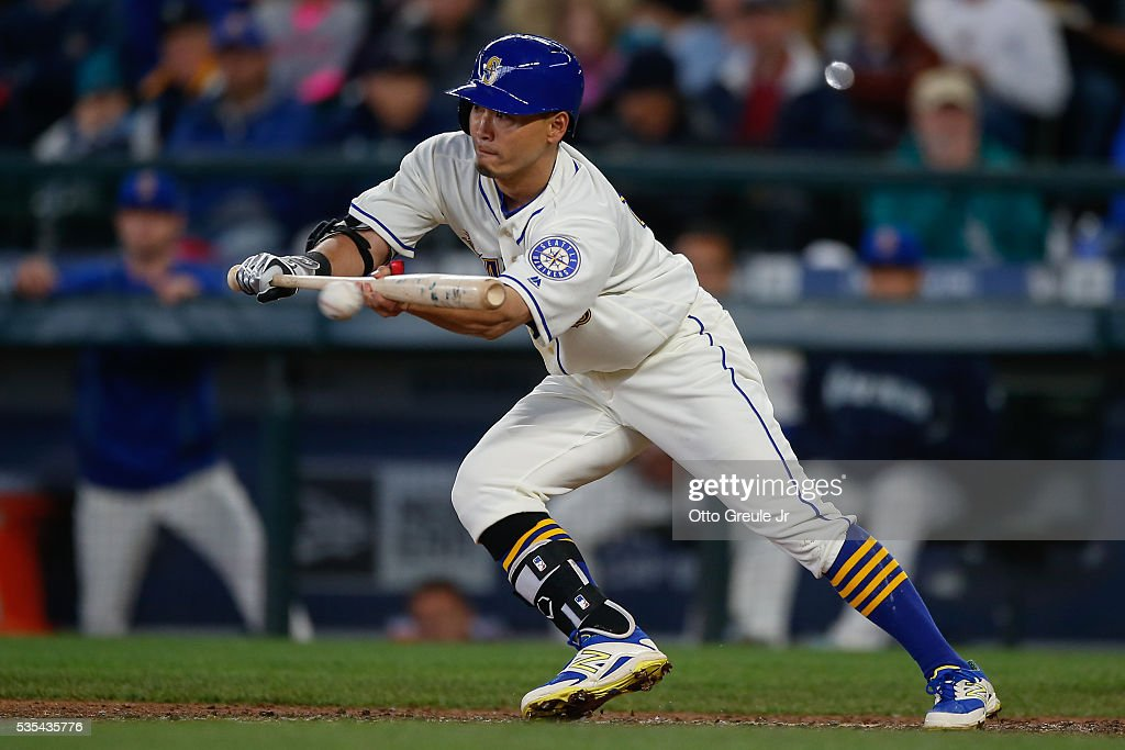 <a gi-track='captionPersonalityLinkClicked' href=/galleries/search?phrase=Norichika+Aoki&family=editorial&specificpeople=850957 ng-click='$event.stopPropagation()'>Norichika Aoki</a> #8 of the Seattle Mariners bunts against the Minnesota Twins in the fifth inning at Safeco Field on May 29, 2016 in Seattle, Washington. Aoki was thrown out at first on the play.