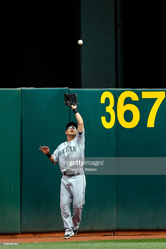 Norichika Aoki #8 of the Seattle Mariners catches a fly ball hit off the bat of Khris Davis (not pictured) of the Oakland Athletics during the first inning at the Oakland Coliseum on May 4, 2016 in Oakland, California.