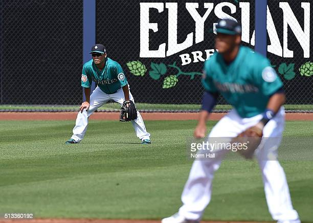 Norichika Aoki of the Seattle Mariners gets ready to make a play in left field during the first inning against the San Diego Padres at Peoria Stadium...
