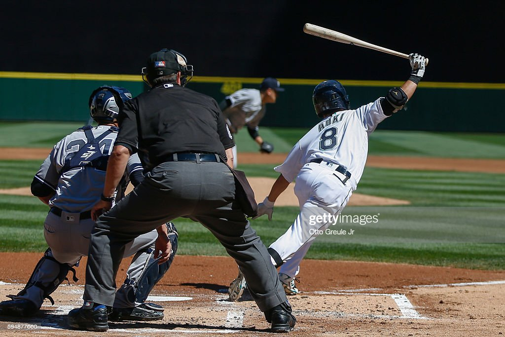 Norichika Aoki of the Seattle Mariners grounds out against starting pitcher Masahiro Tanaka of the New York Yankees at Safeco Field on August 24 2016...