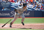 Norichika Aoki of the Seattle Mariners hits an RBI single in the sixth inning during MLB game action against the Toronto Blue Jays on July 23 2016 at...