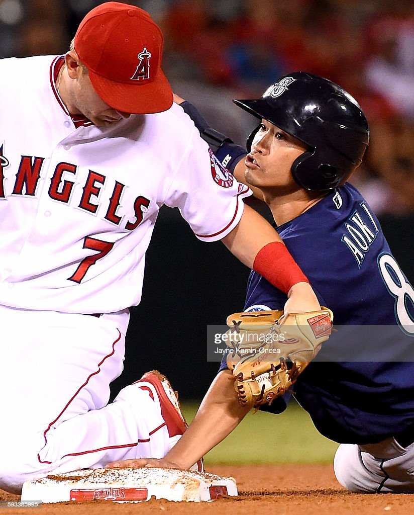 Norichika Aoki of the Seattle Mariners is caught stealing on a tag by Cliff Pennington of the Los Angeles Angels in the eighth inning of the game at...