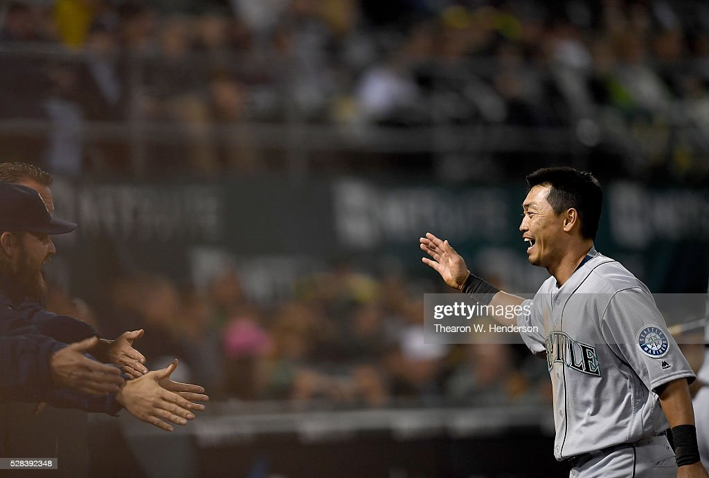<a gi-track='captionPersonalityLinkClicked' href=/galleries/search?phrase=Norichika+Aoki&family=editorial&specificpeople=850957 ng-click='$event.stopPropagation()'>Norichika Aoki</a> #8 of the Seattle Mariners is congratulated by teammates after he scored against the Oakland Athletics in the top of the seventh inning at O.co Coliseum on May 2, 2016 in Oakland, California.