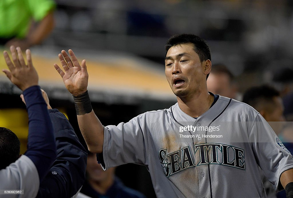 Norichika Aoki #8 of the Seattle Mariners is congratulated by teammates after he scored against the Oakland Athletics in the top of the seventh inning at O.co Coliseum on May 2, 2016 in Oakland, California.