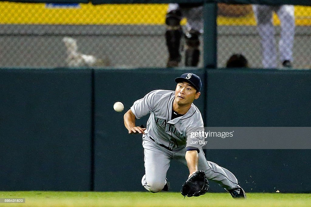 Norichika Aoki of the Seattle Mariners makes a diving catch for an out against the Chicago White Sox during the seventh inning at US Cellular Field...