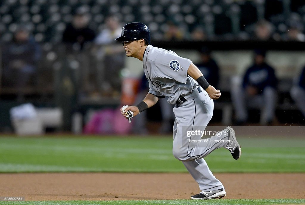 <a gi-track='captionPersonalityLinkClicked' href=/galleries/search?phrase=Norichika+Aoki&family=editorial&specificpeople=850957 ng-click='$event.stopPropagation()'>Norichika Aoki</a> #8 of the Seattle Mariners runs from first base on the pitch against the Oakland Athletics in the top of the seventh inning at O.co Coliseum on May 3, 2016 in Oakland, California.
