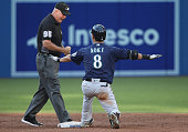 Norichika Aoki of the Seattle Mariners signals that he was safe with a double at second base after he was initially called out by second base umpire...