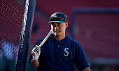 Norichika Aoki of the Seattle Mariners stands behind the batting cage before a game against the Boston Red Sox at Fenway Park on June 17 2016 in...