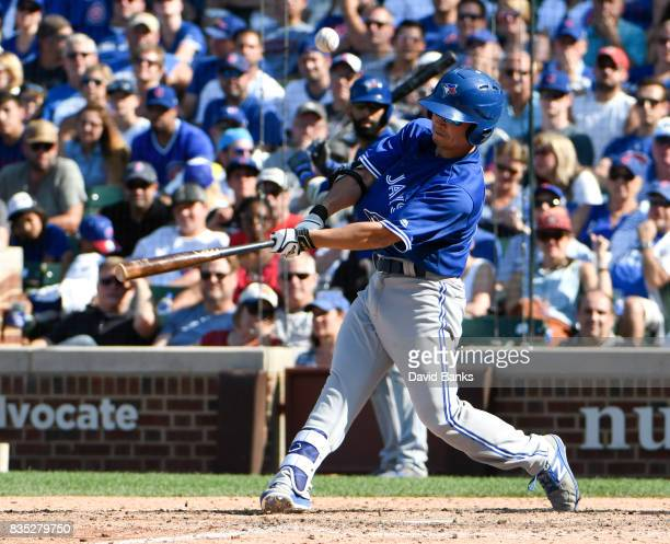 Norichika Aoki of the Toronto Blue Jays bats against the Chicago Cubs during the ninth inning on August 18 2017 at Wrigley Field in Chicago Illinois...