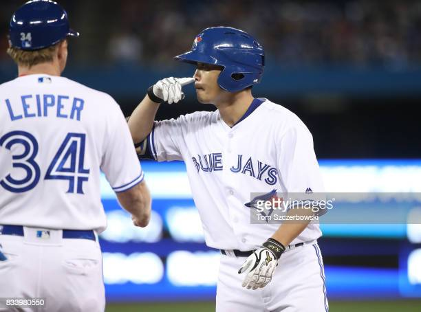 Norichika Aoki of the Toronto Blue Jays celebrates after hitting a single in the third inning during MLB game action against the Tampa Bay Rays at...