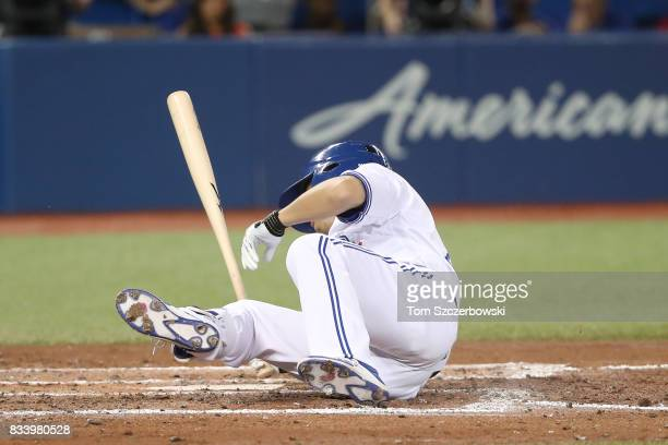 Norichika Aoki of the Toronto Blue Jays falls after being knocked down by an inside pitch in the third inning during MLB game action against the...
