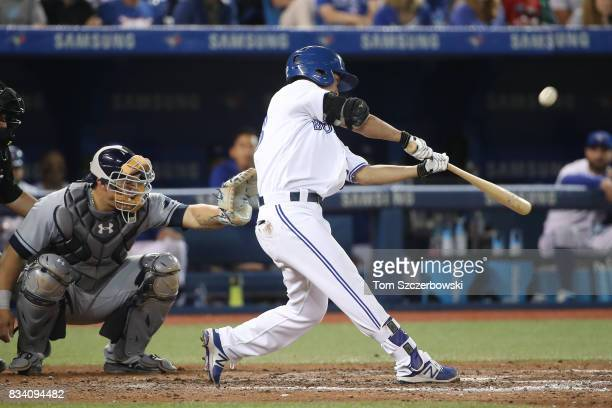 Norichika Aoki of the Toronto Blue Jays flies out in the eighth inning during MLB game action against the Tampa Bay Rays at Rogers Centre on August...
