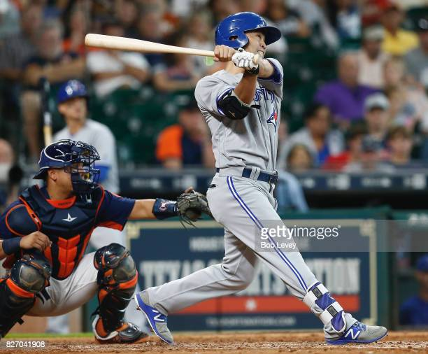 Norichika Aoki of the Toronto Blue Jays hits a two run home run in the seventh inning as Juan Centeno of the Houston Astros watches at Minute Maid...
