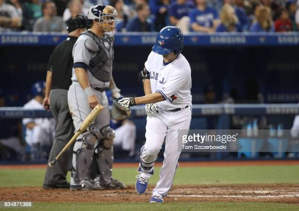 Norichika Aoki of the Toronto Blue Jays reacts as he flies out in the eighth inning during MLB game action against the Tampa Bay Rays at Rogers...