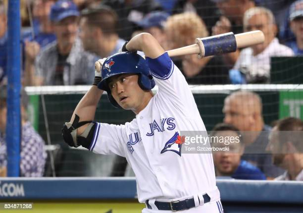 Norichika Aoki of the Toronto Blue Jays swings a weighted bat in the ondeck circle as he prepares to bat in the first inning during MLB game action...