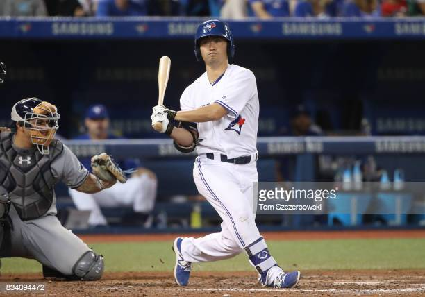 Norichika Aoki of the Toronto Blue Jays swings and misses as he bats in the eighth inning during MLB game action against the Tampa Bay Rays at Rogers...