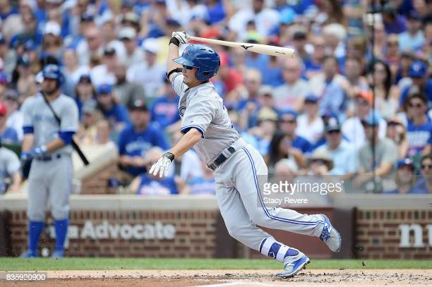 Norichika Aoki of the Toronto Blue Jays swings at a pitch during the third inning of a game against the Chicago Cubs at Wrigley Field on August 20...