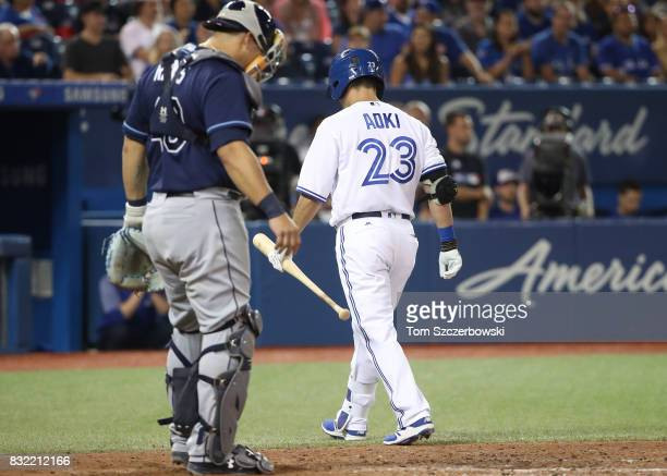 Norichika Aoki of the Toronto Blue Jays walks away after striking out in the ninth inning during MLB game action against the Tampa Bay Rays at Rogers...