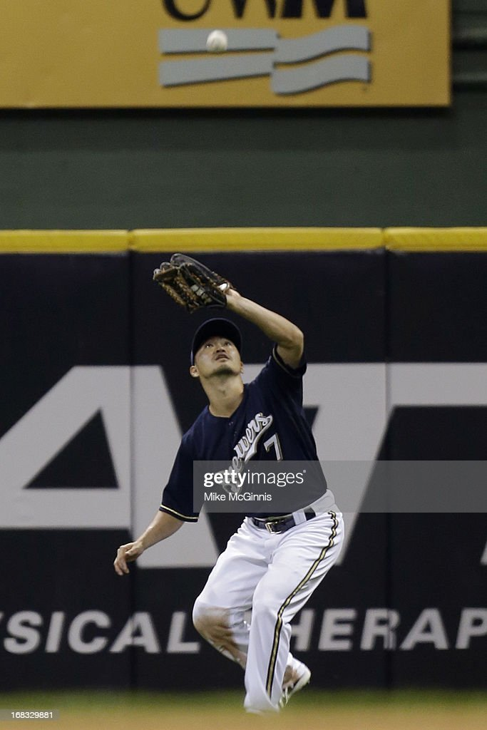 <a gi-track='captionPersonalityLinkClicked' href=/galleries/search?phrase=Norichika+Aoki&family=editorial&specificpeople=850957 ng-click='$event.stopPropagation()'>Norichika Aoki</a> #7of the Milwaukee Brewers makes the catch in right field to retire Nelson Cruz of the Texas Rangers in the top of the fifth inning at Miller Park on May 08, 2013 in Milwaukee, Wisconsin.