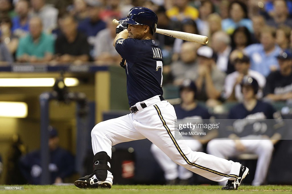 <a gi-track='captionPersonalityLinkClicked' href=/galleries/search?phrase=Norichika+Aoki&family=editorial&specificpeople=850957 ng-click='$event.stopPropagation()'>Norichika Aoki</a> #7of the Milwaukee Brewers singles in the bottom of the third inning against the Texas Rangers at Miller Park on May 08, 2013 in Milwaukee, Wisconsin.
