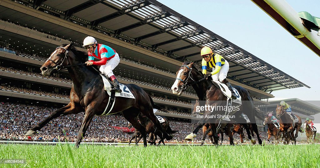 Norihiko Yokoyama riding One and Only (L) takes a lead to win the 81st Tokyo Yushun (Japanese Derby) at Tokyo Racecourse on June 1, 2014 in Fuchu, Tokyo, Japan.