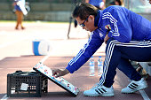 Norio Sasaki coach of Japan works on the lineup during the Women's Algarve Cup match between Japan and France on March 9 2015 in Parchal Portugal