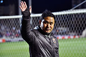Norio Sasaki head coach of Japan applauds supporters after the AFC Women's Olympic Final Qualification Round match between Japan and North Korea at...