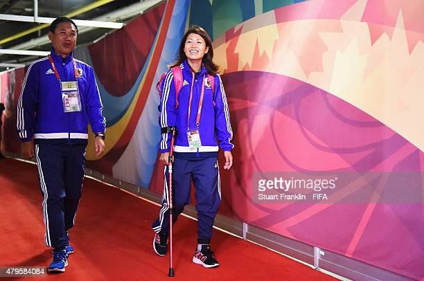 Norio Sasaki head coach of Japan arrives with Kozue Ando at the FIFA Women's World Cup Final between USA and Japan at BC Place Stadium on July 5 2015...