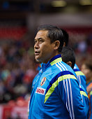Norio Sasaki Head Coach of Japan listens to the national anthems at the team bench prior to Women's International Soccer Friendly Series action...